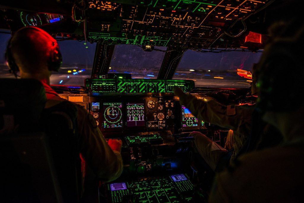 The cockpit of an airplane coming in for a landing at night. Aviation Triad, North Carolina.